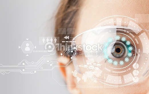 Young woman loking at virtual graphics in futuristic background